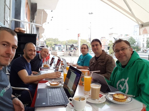 The RightIndem team catching up with work at a local cafe.
