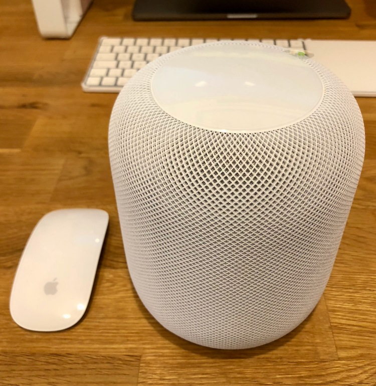 Apple HomePod compared in size to the Magic Mouse